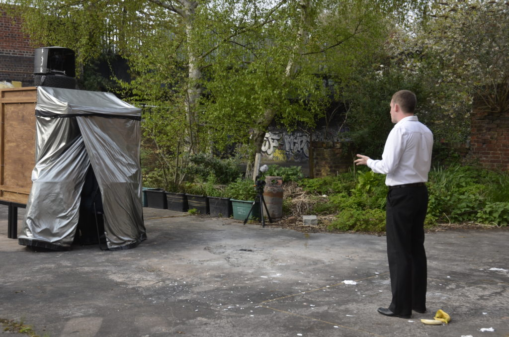 Matthew Tweedale performing to an audience inside the camera obscura.